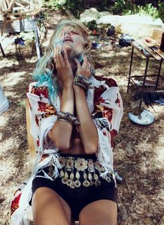 Interesting emotion fashion photo. Loving the gypsy-like belt and the blue bits in the hair!   #gypsy look #blue tipped hair #editorial fashion shoot