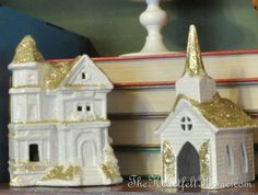 Thrift store Christmas houses spray painted white with gold glitter, @Cha Cha @The Heartfelt Home