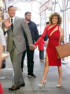 Sizzling in scarlet: Jennifer Lopez wore a red dress as she and Alex Rodriguez went out fo...