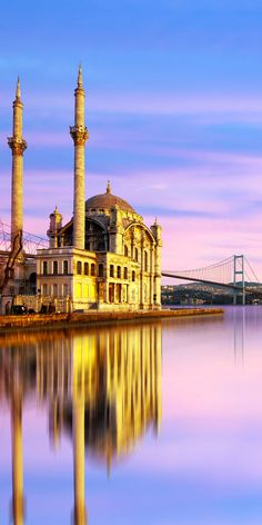 The Bosporus Bridge in Istanbul, Turkey connects Asia and Europe and carries nearly vehicles per day across continents. This cinematic view is one of the top 11 reasons to visit Istanbul. Places Around The World, The Places Youll Go, Travel Around The World, Great Places, Places To See, Around The Worlds, Pamukkale, Islamic Architecture, Beautiful Architecture