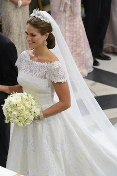 Princess Madeleine of Sweden in her wedding dress by Valentino - pretty, slightly matronly as lace tends to go that way, but still the up-do and veil make up for it.
