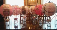 This is my first post :-) I loved making these hot air balloons for my daughters baby shower. These center pieces will also be used as guest prizes. The jelly jars will be filled with pink candy.