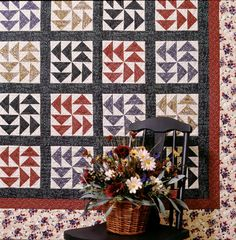 """""""Picnic Potluck"""" from Thimbleberries Quilting for Harvest by Lynette Jensen. Quick and easy Dutchman's Puzzle patchwork blocks make this quilting pattern fun to stitch.  Find it online: http://landauerpub.com/Thimbleberries-Quilting-for-Harvest.html"""