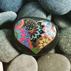 Gorgeous heart and flowers painted rock.