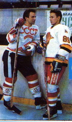 "( ...via Alexia Karman's ""hockey love"" board) -snip- Slava Fetisov (CCCP jersey) chatting with Igor Larionov (Canucks jersey)"
