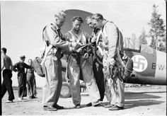 "10 July 1941. Lt. ""Joppe"" Karhunen gives orders to his pilots in front of a Brewster B-239 fighter. The Finnish Air Force used a blue swastika since 1918, well before the Nazis adopted the symbol. Finland ordered 44 Brewsters from the United States, using them with great effectiveness in the Continuation War. Karhunen scored 25.5 of his 31.5 kills using this aircraft. His 24th Squadron had a victory ratio of 26:1, with 477 Red aircraft destroyed with a loss of only 19 Brewsters."