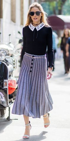 Palermo looked perfectly polished during Milan Fashion Week in a collared blouse and printed midi skirt.