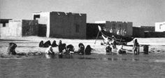 Women washing clothes in the sea at al-Khor – courtesy of Mohammad Naseer