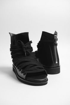 KRISVANASSCHE Black Multilaces Sandals in Calf leather with round toe, back zip closure, wrap around laces and extended lace-up closure.  Upper: 100% Calfskin, Sole: 100% Rubber  Made in Croatia.  EU Sizing.