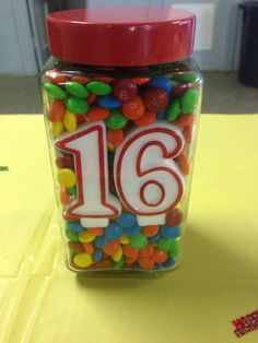 One of my sons likes red and m&m's so this jar has a red lid and is filled with m&m's with red 16 candles.  This was displayed on the cake table for their 16th Birthday Party