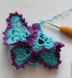 El color negro en el esquema de las alas de la mariposa de tejer son una serie de unión.  Mantiene el hilo en un color contrastante.