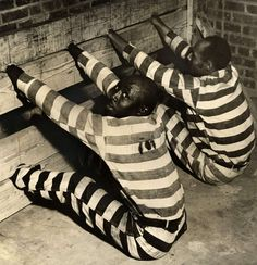 The State Prison of Bibb County, Georgia is modern but old-fashioned offenses are punished. Two trapped in a pillory, hands and feet put in the block.  (1937)
