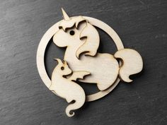 Items similar to Unicorn and baby dragon wood nursery wall hanger - fantasy inspired Christmas ornament - mother and child keepsake on Etsy Wood Nursery, Unicorn Ornaments, Baltic Birch Plywood, Baby Dragon, Jute Twine, Wall Hanger, Mother And Child, Matching Shirts, Christmas Ornaments