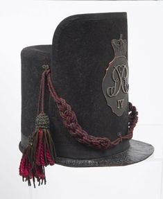 Shako, British Army issue, 1812. The name 'shako' derives from the Hungarian for peaked cap.