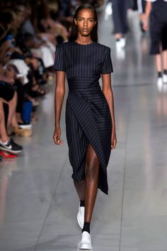 Pinstripe dresses walked in loose sporty shapes and more tailored dresses with a feminine shape. It came in overcoats, blazers, double-breasted sleeveless dresses. If you love a stripe, this is your season.