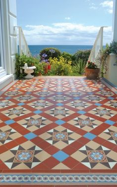 Antique floor tiles are beautiful for every interior and add a touch of luxury style. These colorful tiles are hand made and more than 100 years old, and were salvaged from an old Spanish villa.  (via mediterranean - entry - other metros - by LUXURYSTYLE.es)