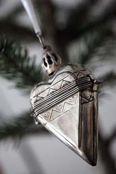heart ornament - Inspiration to utilize other glitzy items unconventional for ornaments. Note: Metal silver spray paint can turn an enexpensive plastic item into glam