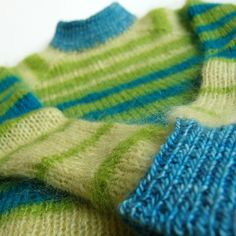 Thinking of spring... handknit bright green and blue, mohair, wool, and silk pullover sweater (or jumper, as the British like to say). May keep this for myself.