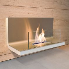 Wall Flame Stainless White  Created by Michael Rösing, the managing director of Radius Design, the impressive Wall Flame is only one of the products in the Home Flame Collection from Radius. At a total length of 31 inches, this piece of living sculpture runs on clean burning ethanol