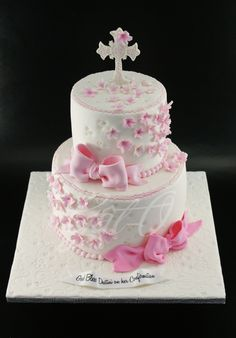 A delicate pink and white cake for a confirmation cake!