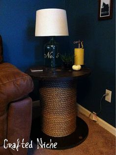 Stunning side tables made with industrial spools and some rope! Now I just have to find a couple large wooden spools.