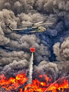 A fire helicopter trying to stop a raging wildfire in Porta Westfalica, Germany. Photo by Frank Wißmann. Fire Dept, Fire Department, Aigle Animal, Wildland Firefighter, Firefighter Training, Volunteer Firefighter, Wild Fire, Ambulance, Fire Trucks