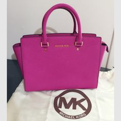 Michael kors large Selma saffiano leather satchel Authentic new with tag Mk large Selma in fuchsia. Carry it on shoulder for a chic look or go hands-free and wear it as a crossbody.  100% saffiano leather. Adjustable strap. Top zip. One inside zip pocket & two open inside pockets. Michael Kors Bags Satchels