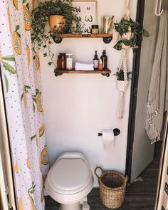 Adding life but not clutter, Jacqueline has adorned the RV with lots of greenery; a papaya-print shower curtain echoes the tiny home's plant life. A woven trash can and wood shelving give the room a chic, organic touch. Decor, House Design, Bathroom Decor, Interior, Home Decor, House Interior, Room Decor, Apartment Decor, Home Deco