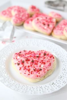 Lofthouse Sugar Cookie Recipe on twopeasandtheirpod.com Super soft sugar cookies cut into hearts for Valentine's Day!