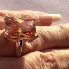 Huge Morganite Ring Huge Morganite Ring Size 8 fancy setting with 3 channel set cz on each side. Silver plate setting pretty champagne color Jewelry Rings