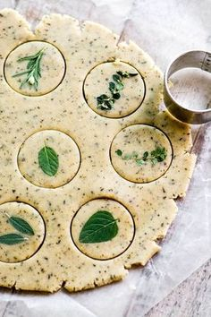 Set out these buttery savory herb shortbread crackers at the cocktail hour for an elegant alternative to chips. I've included a pretty customizable menu and place cards to help you set the theme for a spring brunch or afternoon tea. #appetizer #shortbread #herbs #inagarten #rosemary #sage #thyme #homemadecrackers #printables #printablemenu #partyplanning #mothersday #brunch #freshherbs #savoryshortbread #herbcrackers #recipe