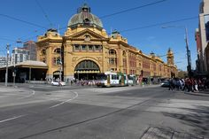 Flinders Street Railway Station at the corner of Flinders and Swanston Streets is the oldest station in Australia (1910). Before this building was erected, the station used to be a series of wooden sheds when the site was first opened as a station in 1854. When it was opened, thousands of people assembled at the station and along the track to Sandridge (today known as Port Melbourne) to see not only Victoria's, but Australia's first public steam train.