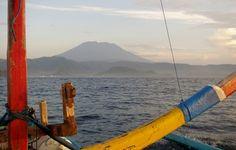 Bali With Kids. Bali's volcano seen from a fishing boat at dawn. #worldtravelfamily #bali