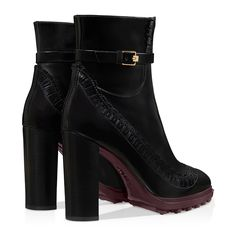 Ankle boots in brushed leather with unique sbizzature perforated detailing, ankle strap, leather-covered block heel and thick rubber outsole.  Tod's