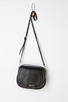 """- By Seen Worn Kept - Detachable crossbody strap - Inner pocket - Turnlock closure - Leather; polyester lining - 7""""H, 10.5""""W, 3.25""""D - 22"""" strap drop - Imported"""