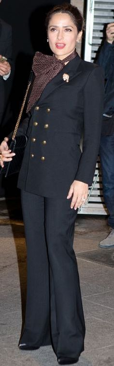 Salma Hayek's black jacket, tie top, and quilted handbag fashion week style id