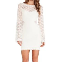 NWT! FREE PEOPLE LOVELY IN LACE SLIP DRESS! XS & S FREE PEOPLE 100% Authentic  WAS $118 NOW $85 Sheer lace bodycon dress with a built-in lining. Cutouts on the sides & an illusion neckline. Rounded neck and Slim sleeves. Scalloped trim. By Free People.  NEW WITH TAGS    *95% Nylon  *5% Spandex  *Hand Wash Cold