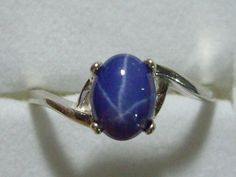 "Dark Blue Star Sapphire (aka ""Lindy"" star) ring.  Mine is a lighter blue with two tiny diamonds on either side.  The first ring my boyfriend ever gave me when I was 16 (1972)!"