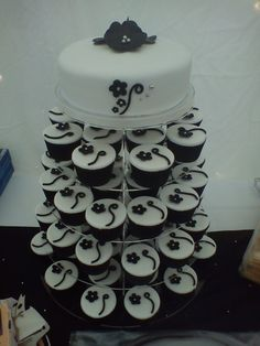 "- Black and white themed wedding cupcakes and 8""top cake.This was for my sisters wedding,the top cake was vanilla with jam and buttercream filling and the cupcakes were a mixture of 35 chocolate and 35 vanilla."