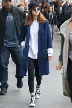 Wearing a White + Warren beanie, navy Chanel coat, white sweatshirt, leggings, converse and round-eyed sunglasses in Melbourne, Australia.
