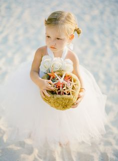 Instead of flowers, have her throw starfish! Love this idea. Flower Girl photo by KT Merry.