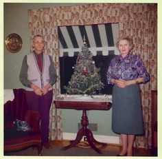 Older couple with their tree.   If that awning wasn't in the way, maybe people could see it from the outside!