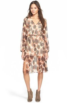 Free shipping and returns on Painted Threads Print Long Sleeve Midi Dress at Nordstrom.com. Orbs of soft earthtone color float over the airy overlay of an ultrafemme midi dress styled with a surplice bodice, long sleeves and flowing, vented skirt.