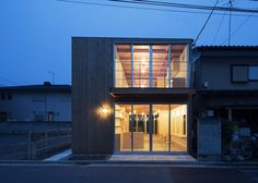 Wooden house by Suzuki Architects also contains a hair salon