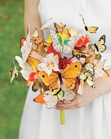 Hot glue butterflies on wooden skewers for table decorations. Kids take home