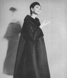 Dovima, October Vogue 1956    Coat by Harry Frechtel.