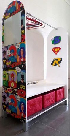 Superhero Open Cabinet - A simple cabinet for hanging your son's clothing can become super by either painting some superhero designs or sticking some comic book pages on the sides. Make dressing up fun.