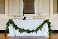 Hitched: Emily & Sean's History Museum Wedding, Pt 3 Table Garland, Leaf Garland, Kauai Wedding, Our Wedding, Wedding Ideas, Wedding Flower Decorations, Wedding Flowers, Chicago History Museum, Barn Parties
