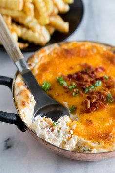 This warm loaded baked potato dip is served hot and full of delicious flavor. Full of cream cheese, sour cream, green onions, bacon and of course CHEESE!