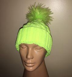 A personal favorite from my Etsy shop https://www.etsy.com/listing/258894527/phosphorus-green-fur-pom-pom-knit-hat